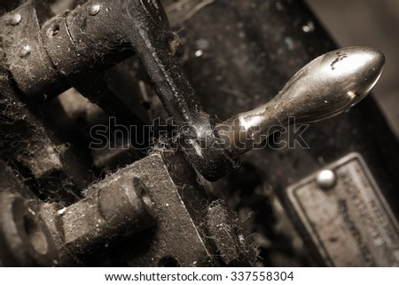 Old dusty cast iron machine - stock photo