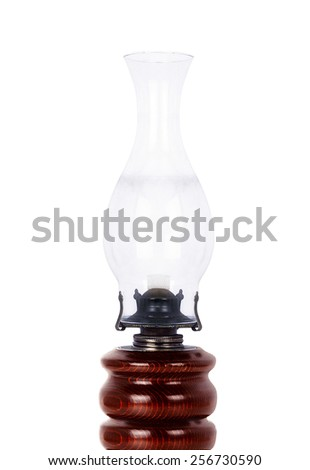 Old dusty oil lamp isolated on white - stock photo