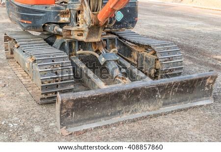 old dusty small Bulldozer - stock photo