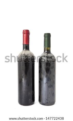 Old dusty wine bottles on white background - stock photo