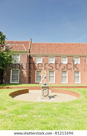 Old dutch houses in old town on hot summer day with blue sky, Enkhuizen, the Netherlands - stock photo