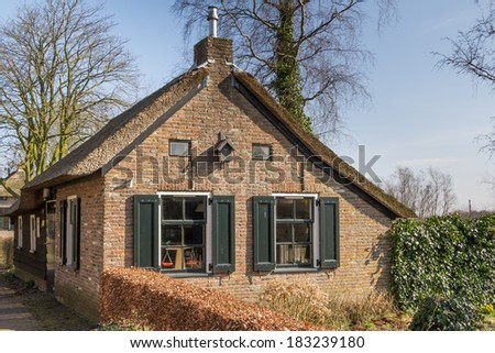 Old Dutch thatched house - stock photo