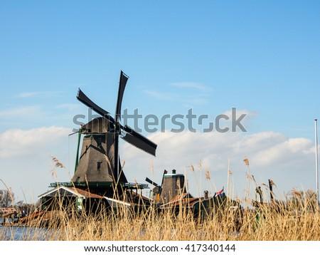 old Dutch traditional windmill at Zaanse Schans, Netherlands - stock photo
