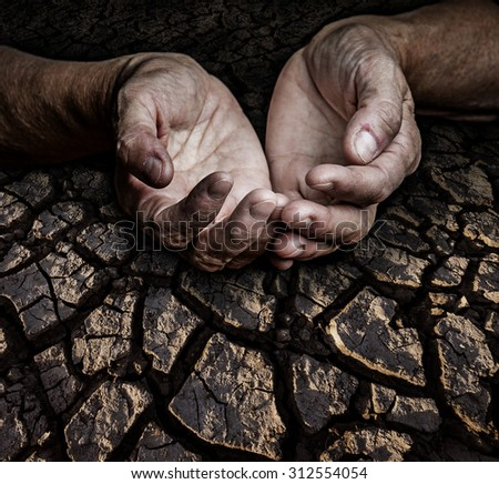 old elderly hands and dry earth - stock photo