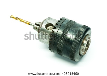 Old electric drill head and drill bit on white background - stock photo