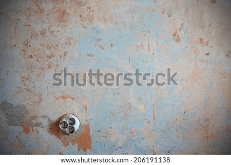 Old electric outlet on a rusty wall. Horizontal photo - stock photo