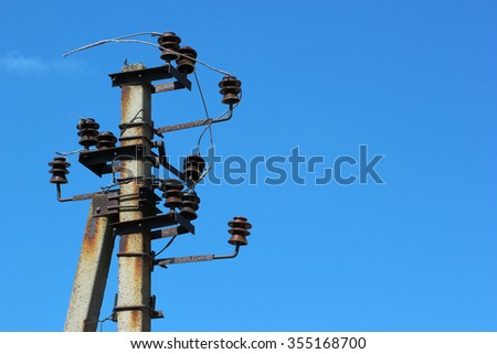 Old electric pole, abandoned power line with no wires.