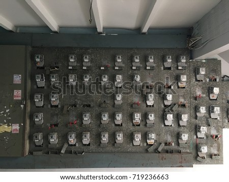 Old Electrical meters on board in half shade.