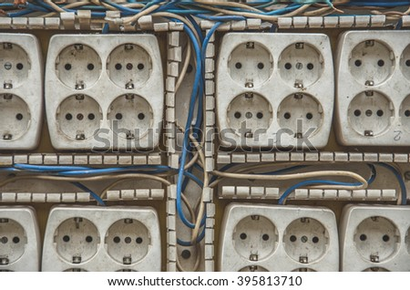 Old electrical outlet sockets table and wires - stock photo