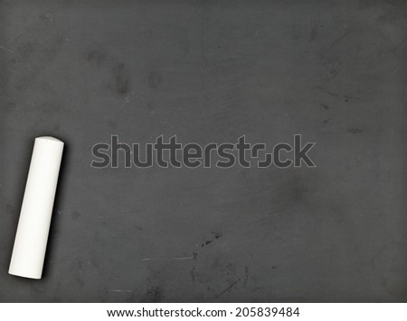 Old empty blackboard with piece of white chalk - stock photo