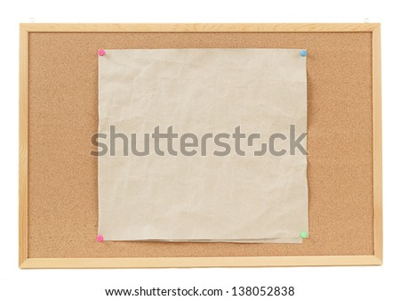 old empty crumple paper on cork board - stock photo