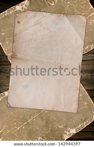 Old empty papers on wood