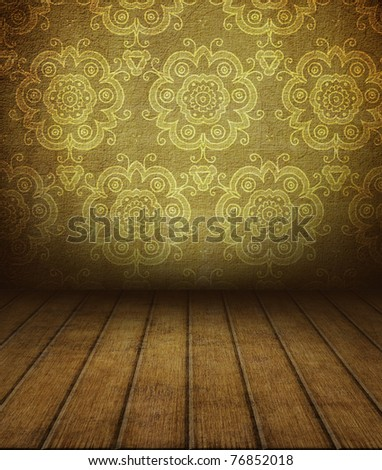 old empty room with antique pattern on wall