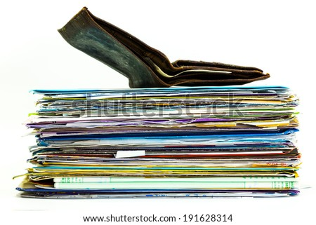 Old empty wallet on top of Mails and bills on stacking - stock photo