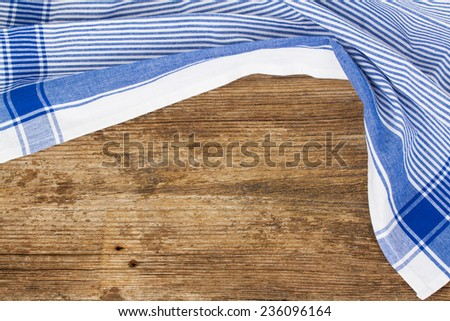 old empty wooden table   and cloth blue napkin - stock photo