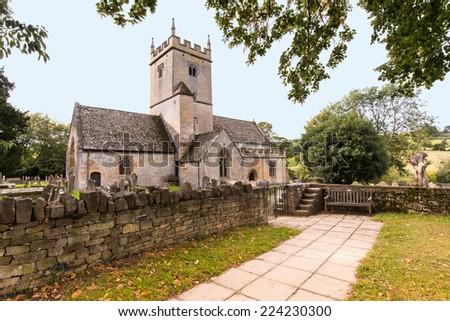 Old English Church and Graveyard - stock photo