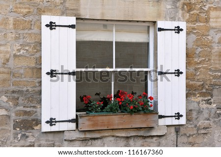 Old English Cottage Sash Window with Shutters and Flower Box - stock photo