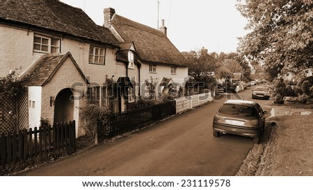 Old English Street in Sepia - stock photo