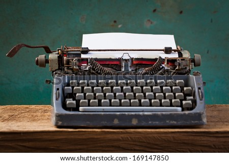 Old English type writer with paper sheet , still life - stock photo