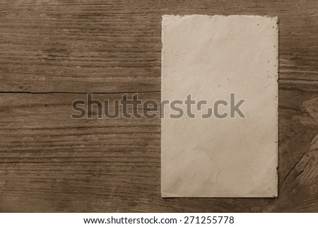 Old envelope on dirty wooden background