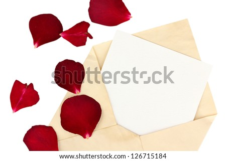 Old envelope with blank paper and dried rose petals isolated on white - stock photo
