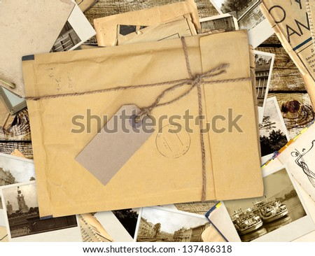 Old envelope with label and retro photos - stock photo