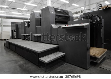 old equipment for a press in a modern printing house - stock photo