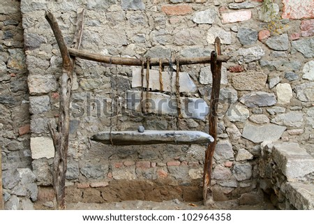 Old Ethiopian anvil made of wood and stone - stock photo