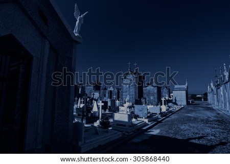 Old european cemetery at night. Used digital filters. - stock photo