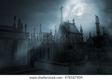 Old european cemetery in a foggy full moon night