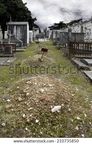 Old european cemetery with abandoned tombs - stock photo