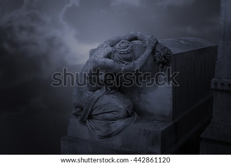 Old European cemetery woman statue. Conceptual image about sorrow
