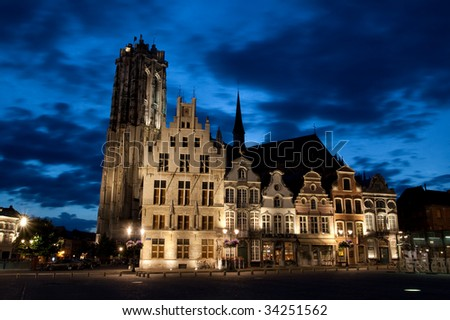 Old european city houses shot in the dusk against blue sky - stock photo