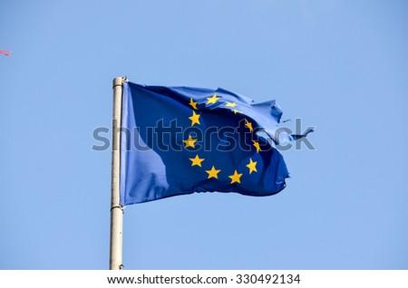 Old European Flag on a Blue Sky - stock photo