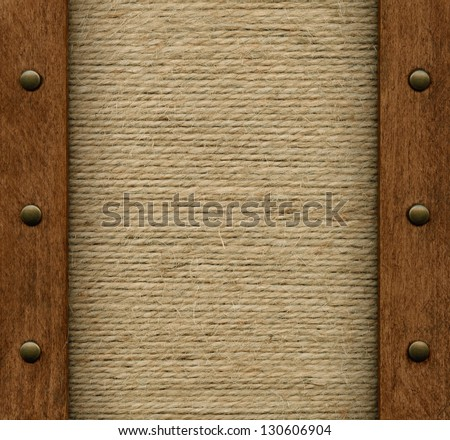Old fabric in wooden frame - stock photo