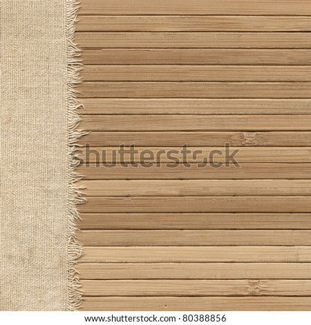 Old fabric in wooden wall - stock photo