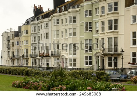 old facades at Brighton, foreshortening of facades of old houses on an uphill street in touristic sea town,  Brighton, East Sussex  - stock photo