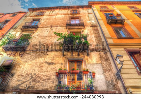 old facades in Bosa, Italy. Processed for hdr tone mapping effect.