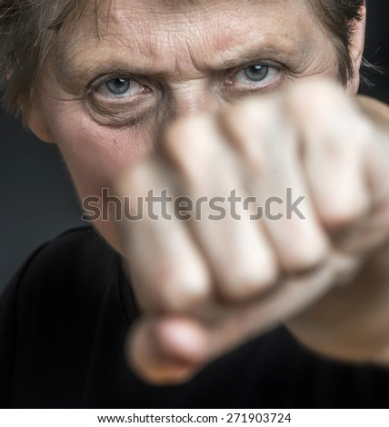 old face and fist - social problems - stock photo