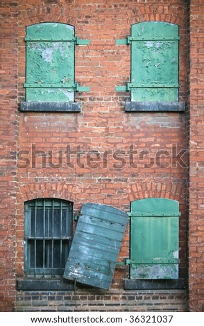 old factory brick wall and windows / abstract grungy background