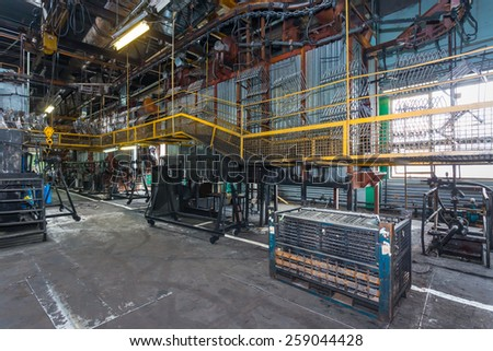 Old factory for the production of car seats. Conveyor line - stock photo