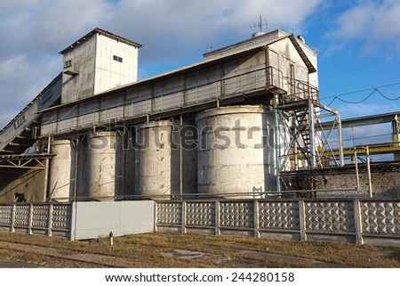 Old factory in the industrial district - stock photo