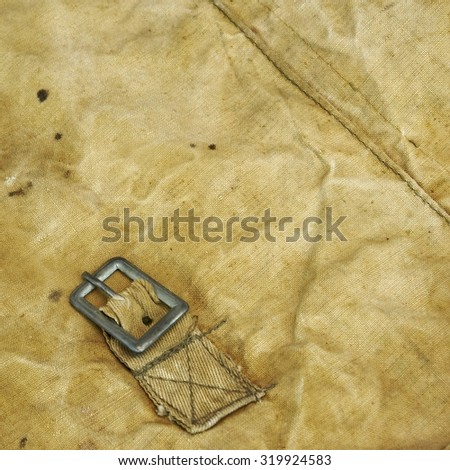 Old Faded Military Army Camouflage Backpack Or Bag Or Uniform Square Frame Background Texture Close-up Top View