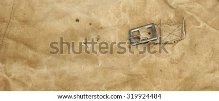 Old Faded Military Army Camouflage Backpack Or Bag Or Uniform Wide Background Texture Close-up Top View