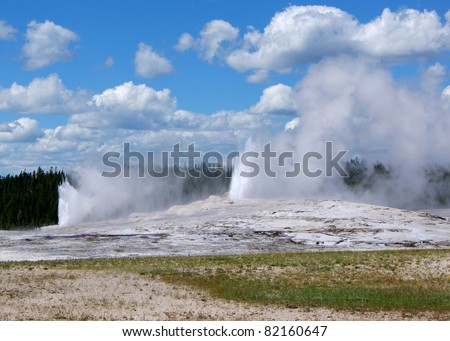 Old Faithful and Grand Geyser erupting at the same time