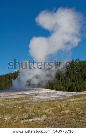 Old Faithful at Yellowstone National Park - stock photo