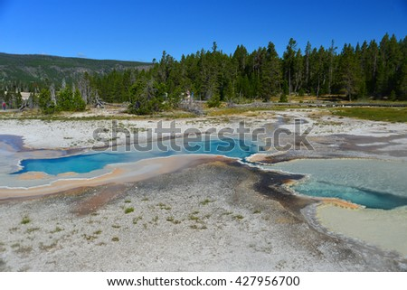 Old Faithful basin in Yellowstone National Park - stock photo