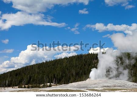 Old faithful geyser erupting in Yellowstone National Park - stock photo