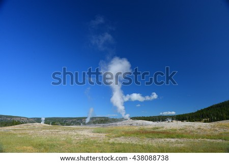Old Faithful geyser, Yellowstone National Park - stock photo