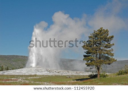 Old Faithful geyser, Yellowstone National Park, Wyoming - stock photo